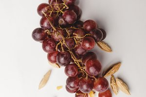 Top view of grapes and almond on whi