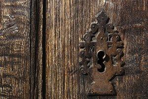 old rusty  lock in wooden door
