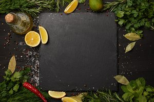 Black slate board with fresh herbs a