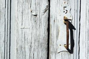 old rusty gray wooden door