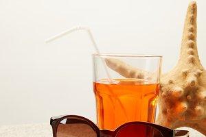 close up view of sunglasses, cocktai