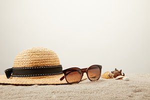 close up view of straw hat, sunglass