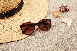 close up view of straw hat, seashell