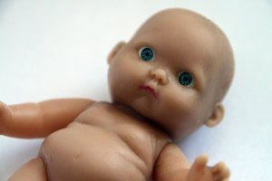 Baby doll, kids toy. Spooky doll