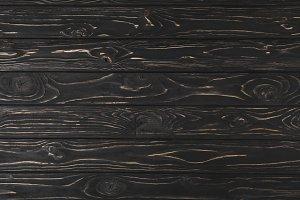 full frame image of dark rough woode