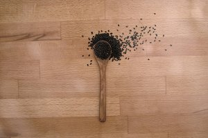 Seeds on Wooden Spoon & Background