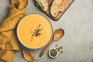 Pumpkin cream soup on concrete