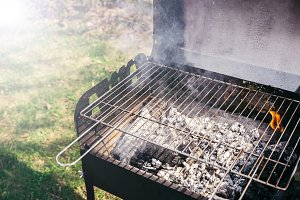 Grill with burning coals ready for b