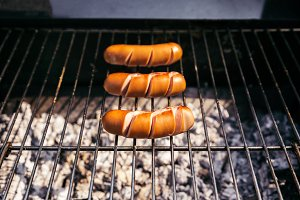 Three sausages grilled for outdoors
