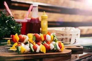 Vegetables on skewers with ketchup a