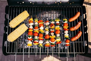 Sausages cooked outdoors on grill wi