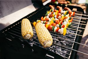 Corn cobs and vegetables on skewers