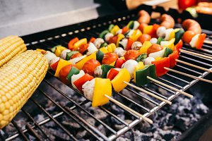 Sausages and vegetables on skewers g