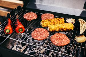 Meat patties and vegetables cooked o