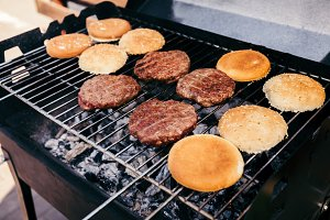 Buns and meat patties grilled for ou