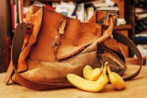Orange suede bag and bananas
