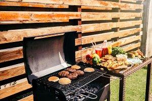 Seasonal vegetables and burgers cook