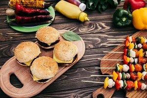 Seasonal vegetables and burgers gril