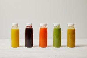 detox smoothies in bottles standing