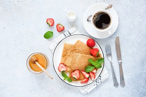 Crepes or blinis with strawberries