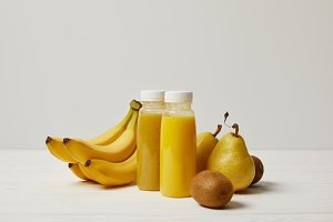 yellow detox smoothies in bottles wi