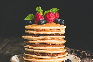 Pancakes with berry fruits, honey