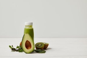 smoothie with green avocado, kiwi an