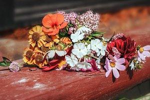 Summer bouquet on wooden step