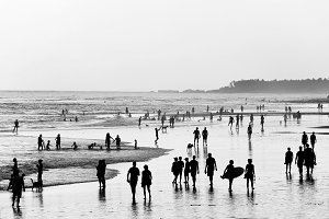People walking on  beach. Bali