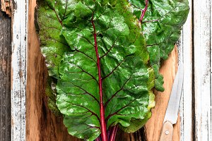 Swiss chard leaf on wooden table