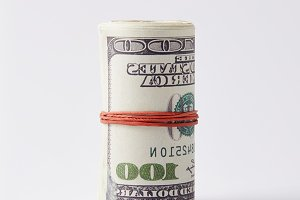 roll of dollars tied with rubber ban