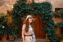 smiling traveller woman in Pienza, I
