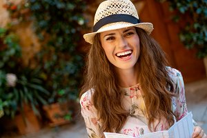 smiling trendy traveller woman with