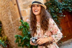 tourist woman with retro film photo