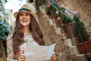 tourist woman with map looking into
