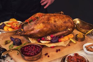 Roasted goose with herbs berries and