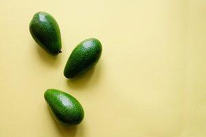 Organic avocado on color background