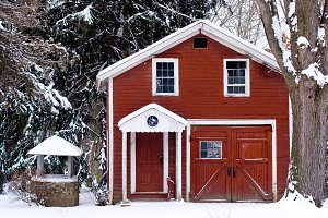 Red Rustic Cabin In Winter