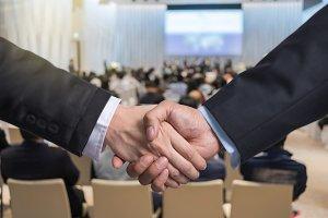 Business shaking hands of partner ov