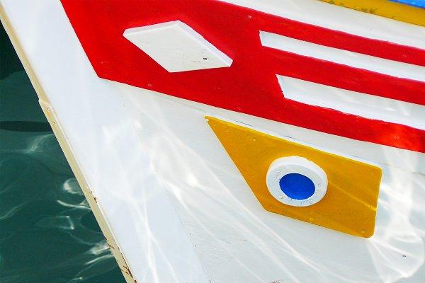 Stock Photos: PixaBear Studio - Colourful boat in blue sea