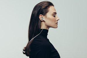 Woman in black with earphones