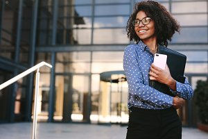 Happy business woman standing