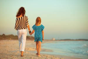 stylish mother and daughter on seaco