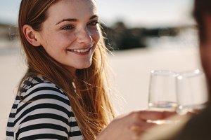Beautiful woman toasting champagne