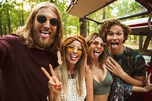Photo of joyful hippie people men an