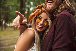 Happy hippy couple man and woman smi