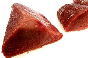 Fresh loins of tuna red at market
