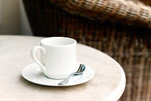 White coffee cup and saucer on a tab