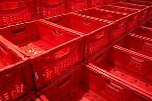 Empty red boxes row at market