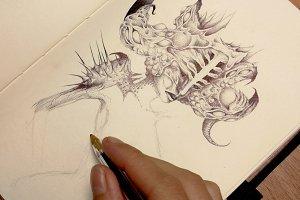 Calm hands drawing comic with a pen
